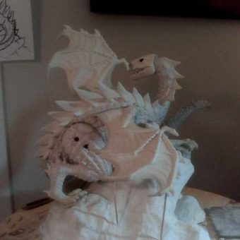 The Dragon's wing replaced and detail worked into the wing's shoulder joint...  Vargas' head starts to take shape.