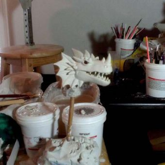 This is as close as you will ever come to seeing me sculpt a Dragon's head on a spike. Removing it makes it much easier to put detail into his face - it is a very delicate and time-consuming process.